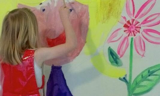 Child painting on wall