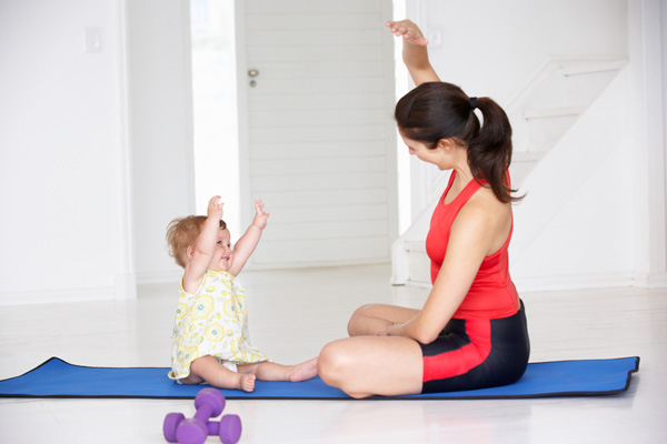 mummy and child exercising