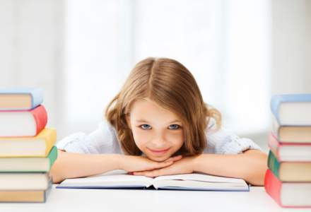 girl at a desk with books