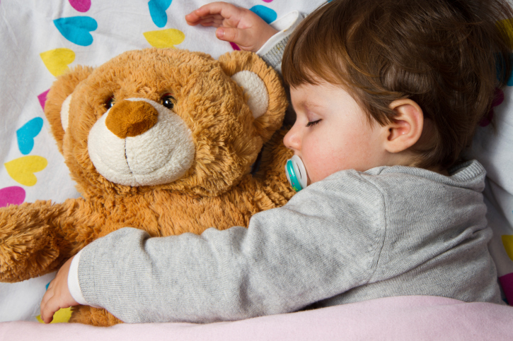 toddler asleep with teddy
