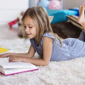 Reading a book – a real life Matilda, I always had my head in a book.