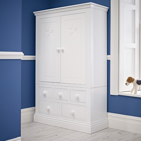 Multi-purpose wardrobe next to a wall with a stuffed toy dog