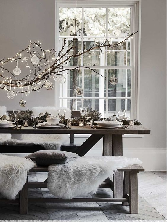 A table with rugs and white Christmas decorations