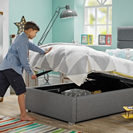 Child opens a bed to reveal storage space underneath from Room to Grow