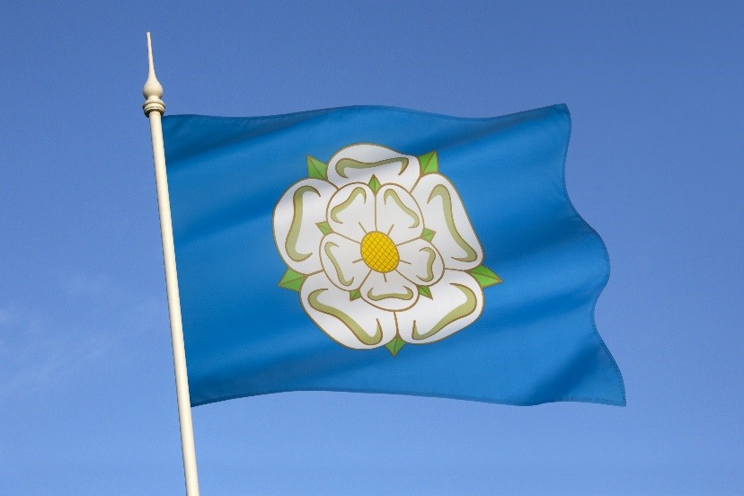 The Yorkshire flag flying against blue sky.
