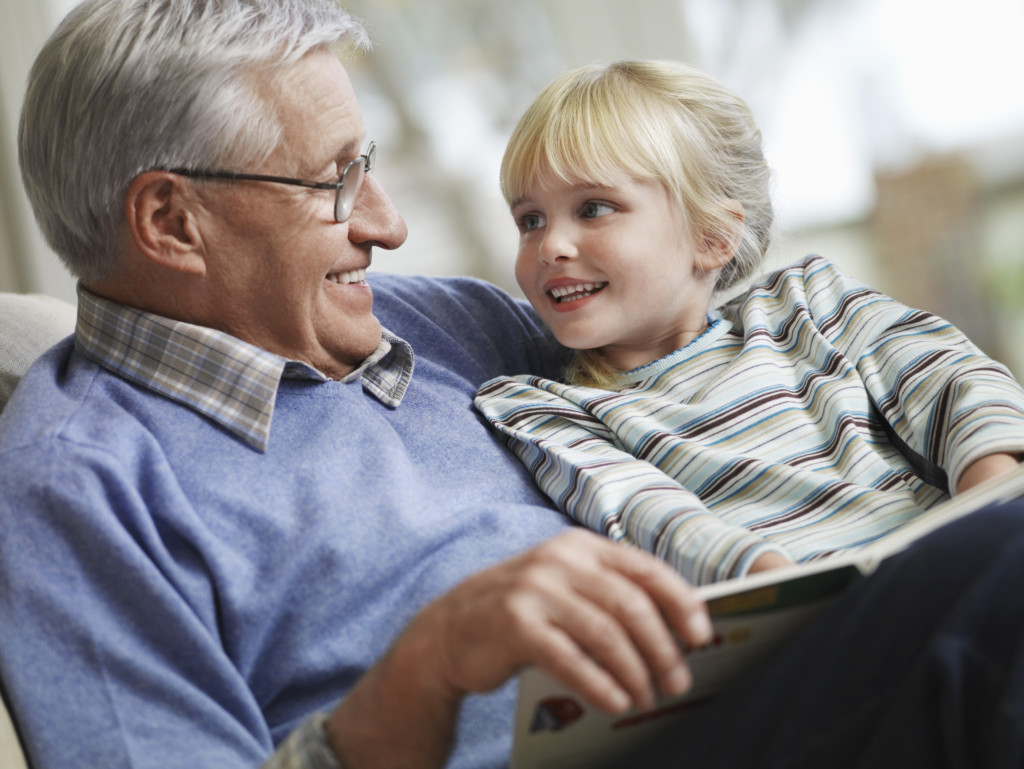 Child sits with grandparent