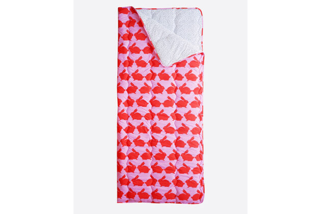 Bright pink and red kissing rabbits on the outside and contrasting black and white dot print make this sleeping bag not just cosy but fun and funky. It is perfect for sleepovers, lazy days relaxing on the sofa or even wild nights camping