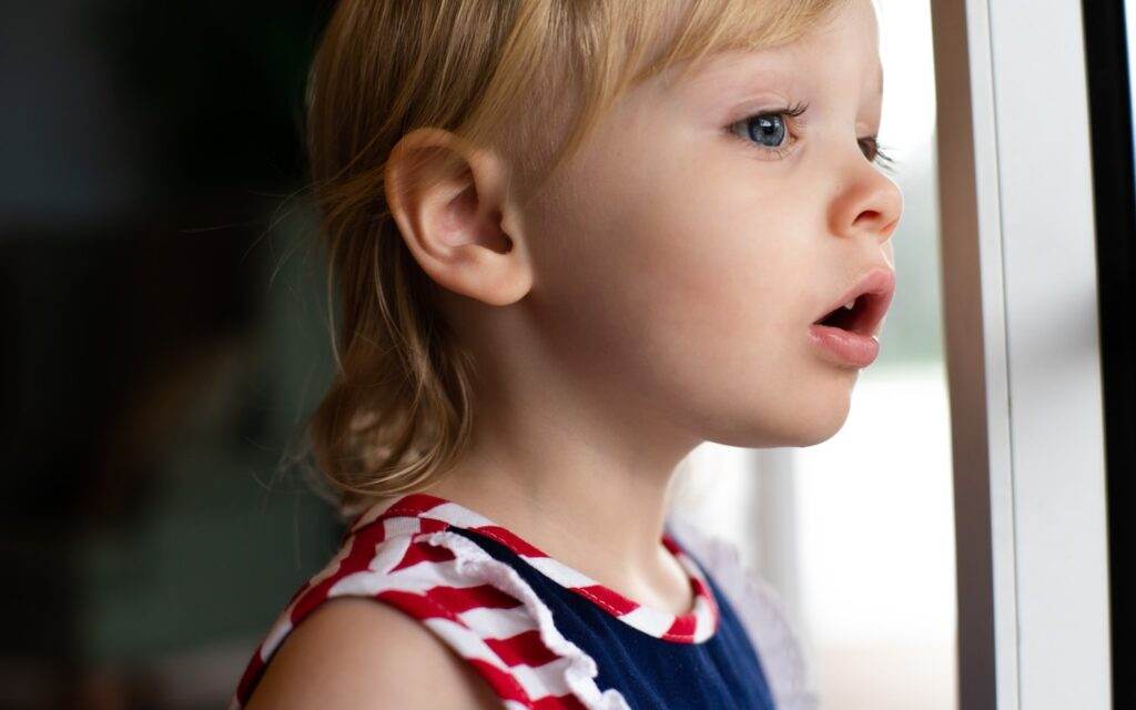 Toddler Looking Out Of Bedroom Window